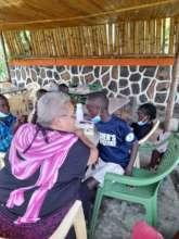 Mentor- Teaching the children bag making