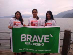 Mentors with the new Brave Girl Rising flag.