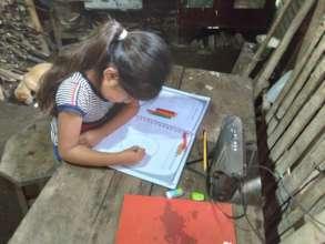 Marleni working on her radio booklet