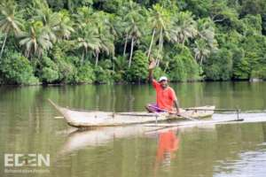 Indonesia - Man in Canoe