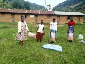 Girls Empowerment Program Students Receiving Beans