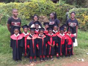 Our 11 nursery school grads ready for 1st grade!