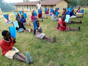 Empowerment Program Students Receiving Workbooks
