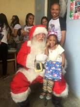 Marlyn with Santa during the Christmas event