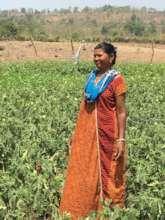 Saku in her Organic Okra farm