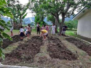 Parents preparing the garden plot.