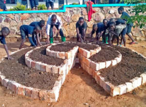 Students creating a tiered garden.