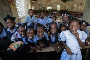 Schoolkids in Haiti (Photo Credit: Jon Brack)