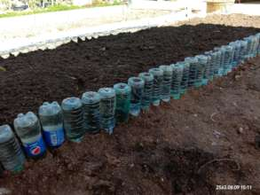Recycling plastic bottles for a watering system