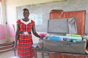 Teacher Irene showing how she stores reading books