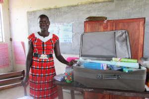Teacher Irene - Storing Books in a Suitcase