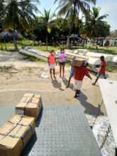 Unloading Antillana fish donations