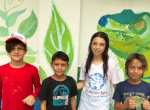 Artists of the community center's ecological mural