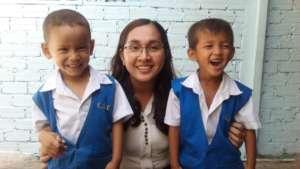 SCC school Principal & students from grade 1