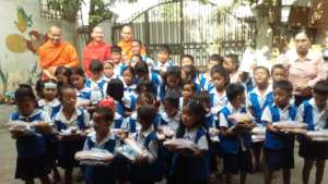 Monks sometimes donate food & books
