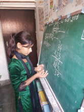 A young girl showing her math skills