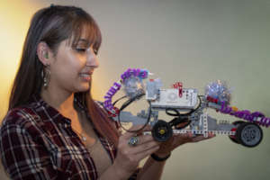 Kimberly proudly shows her robot