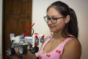 Young woman training in robotics