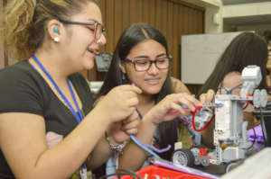 Young deaf women enjoying the robotics course