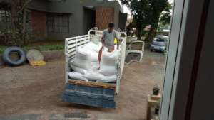Unloading the fodder at the rescue camp