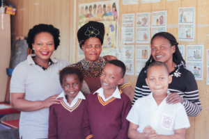 Alwaba with her teachers and friends