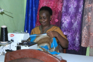 beneficiary with her brand new weaving machine