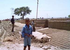 Boy who works in a brick kiln