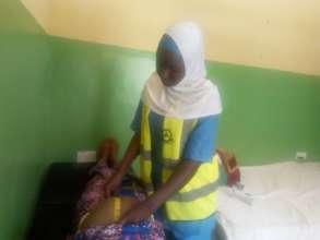 A volunteer doing antenatal screening