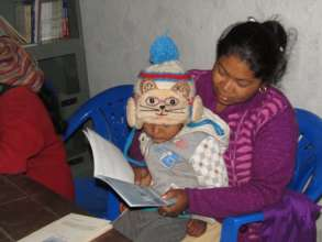 Champa Thami & child reading a book at Babare CLC