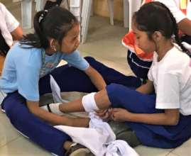 Little Nurses practice bandaging classmates