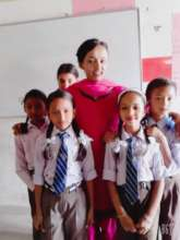 Teacher Bina with some of her students