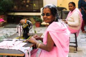 Offer a sewing machine to a Rajasthani woman