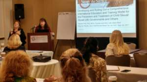 Pamela J Pine speaking at session