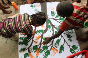 Children painting at SEED's after-school club