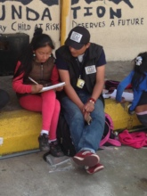 Street outreach worker helping with homework