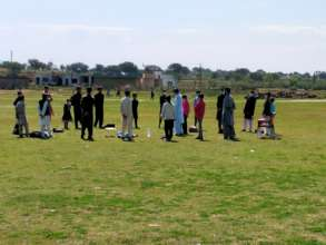 Classes in open fields near school