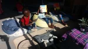 The Ncinci Ones enjoying their book corner
