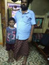 Gokul with his father with a new device