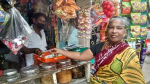 A relieved Saroja buying provisions for the family