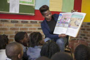 A Khanyisa Reading Partner reading a story