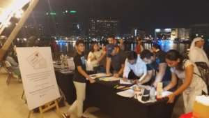 Sean at his Pop-Up, collecting letters, in Dubai