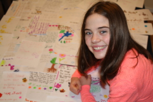 Gabby with the handwritten letters she collected