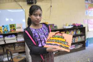 A student shows off her collage
