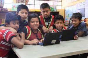 Student literacy ambassadors (in vests) use RACHEL