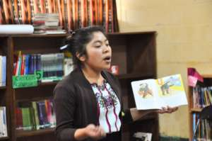 Ms. Clara reads aloud to students