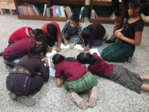 Older students participate in a writing activity