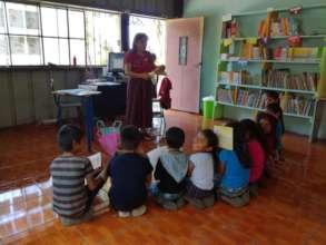 Storytelling at the Patzilin Abaj library! (2018)