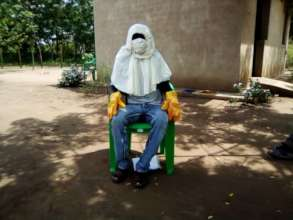 Nursery worker in protective gear against COVID