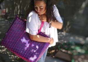 Artisan Karina with her woven bag design