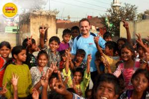 Children with Matthew Spacie Founder Magic Bus